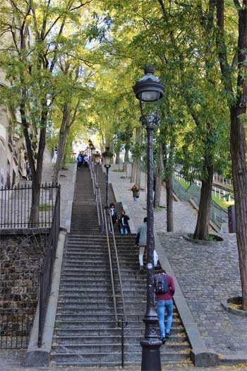 Steep steps at Montmartre leading, lined with trees and lampposts