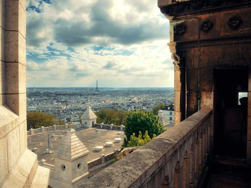 View over Paris, the Eiffel Tower in the distance, from the top of Sacre-Coeur Basilica Paris