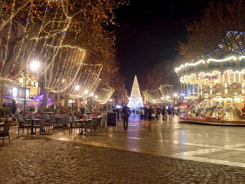 Christmas decorates in a square lined with trees in Avignon in Provence