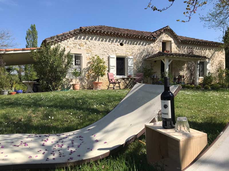 Beautiful stone house with big garden, sun bed and bottle of wine in garden, Gers France
