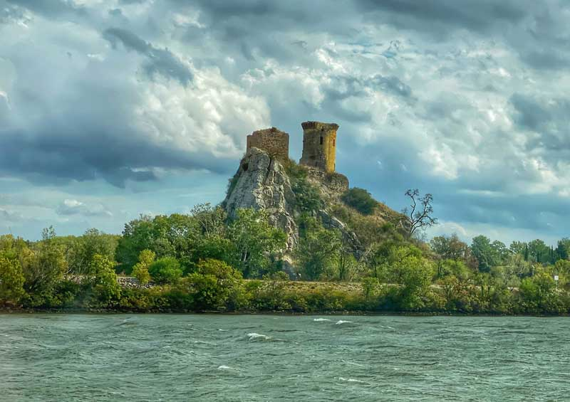 View of a ruined castle in Provence from a Croisieurope ship as it cruises the River Rhone