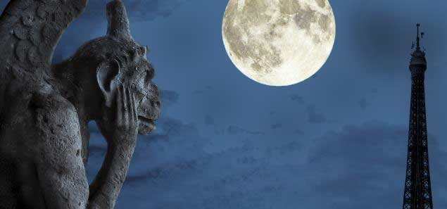 Gargoyle under a full moon, the Paris Eiffel Tower in the background