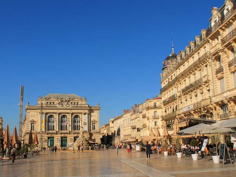 Huge paved square surrounded by bars and restaurants, Place de la Comedie, Montpellier