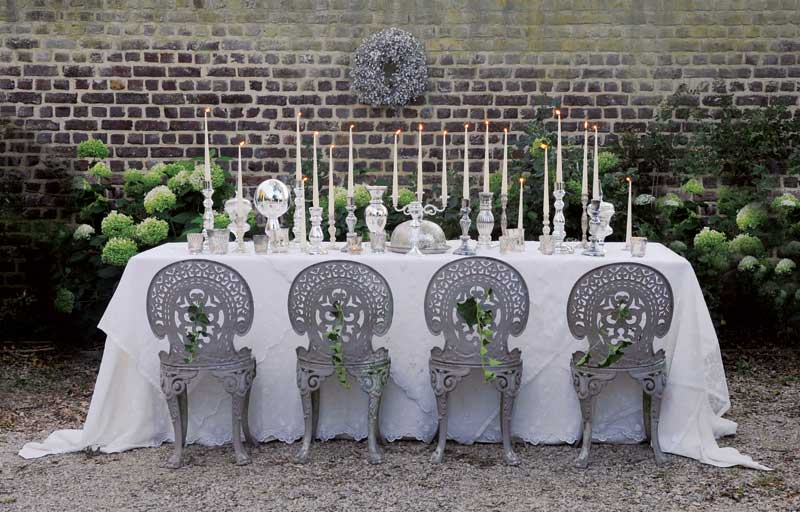 Table decorated with candlesticks and beautiful table cloths