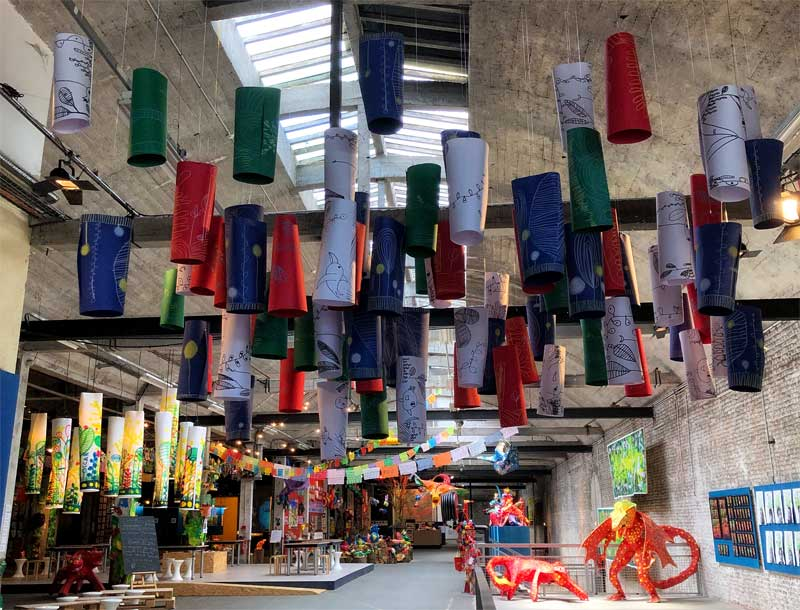 Paper lanterns hanging from the ceiling of a converted railway station now art venue in Lille
