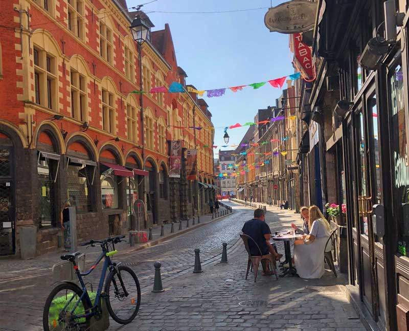 Cobbled Street in Lille, northern France, lined with ancient buildings and quirky bars
