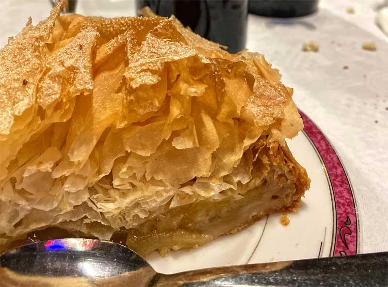 Slice of apple pie made with crispy filo pastry