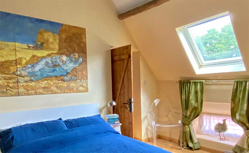 Bedroom with reproduction Van Gogh painting on wall