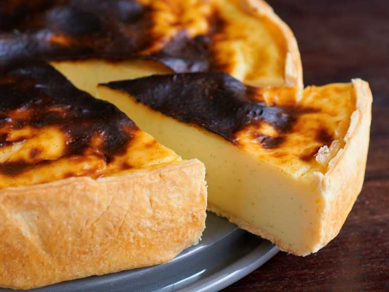 French custard tart on a plate, thick eggy custard with a golden crust