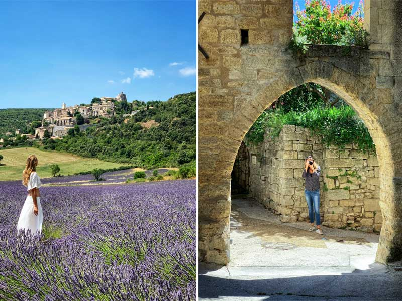 Woman stands in a field of lavender looking at a hill top village in Provence