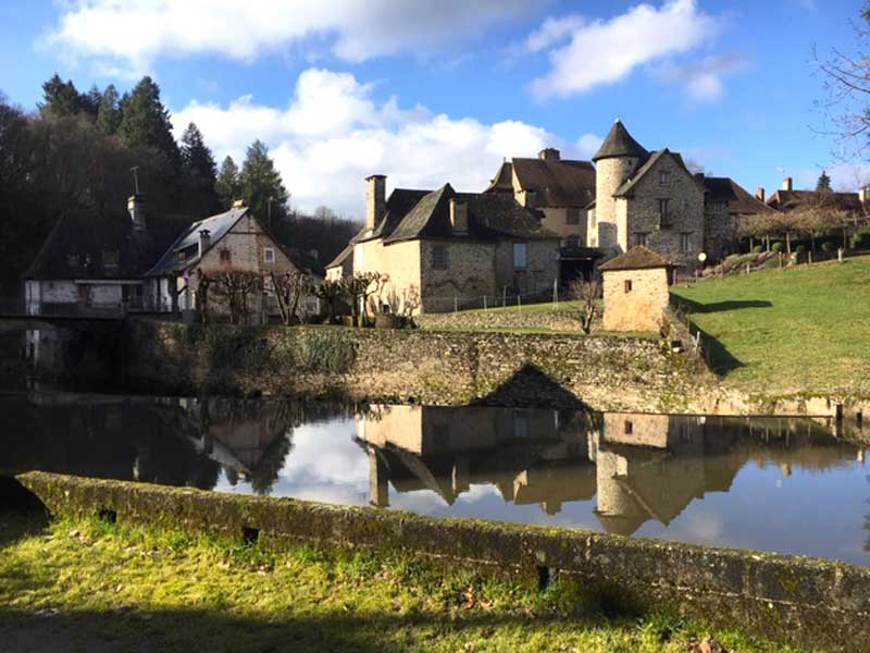 Pretty houses in a village at the side of a river in Correze, Limousin