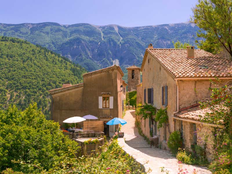 A street in the village of Brantes with striking view of Mont Ventoux in the background