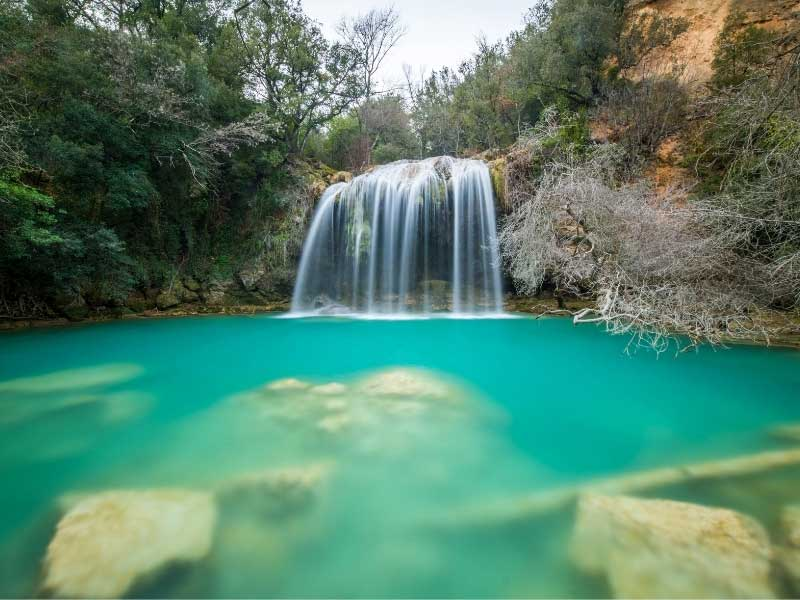 Waterfall in Sillans de Cascade, Provence, a turquoise pool at the base