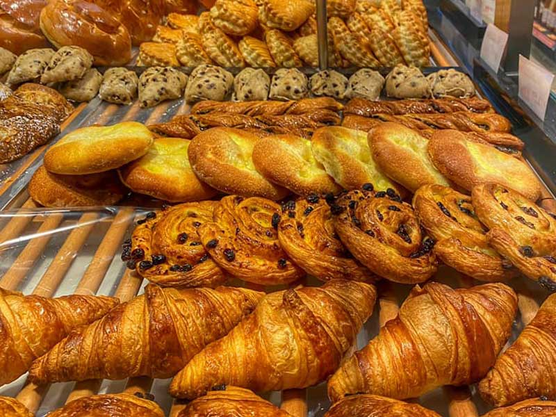 Croissants, pastries and cakes on display in a French bakery