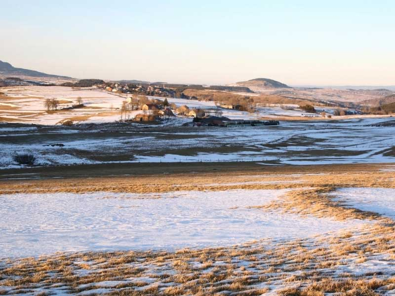 Snow over a village in the hills of Auvergne France on a chilly winter day