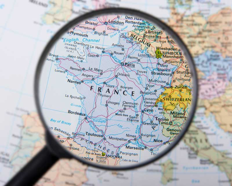 Map of France seen through a magnifying glass
