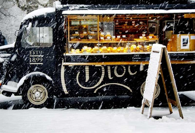 Food truck selling bread and pastries in the snow in France