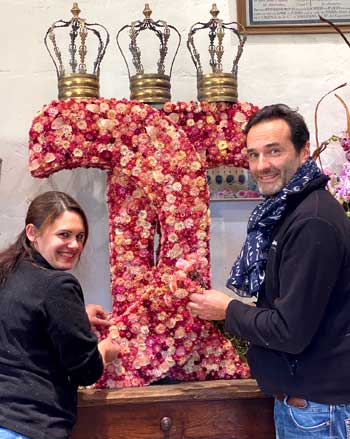 Man and woman working together to create a floral masterpiece