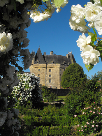 Chateau surrounded by gardens of trees and flowers, Jumilhac, Limousin