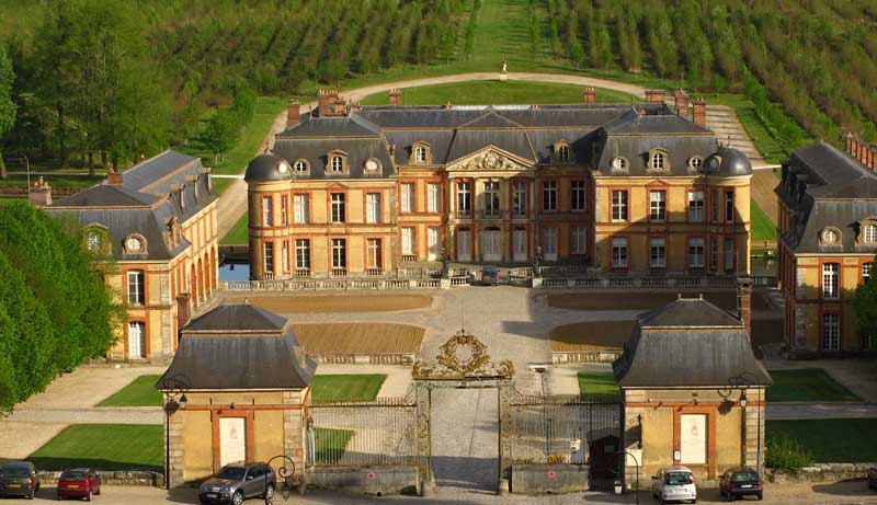 Beautiful chateau of Dampierre surrounded by vineyards near Paris