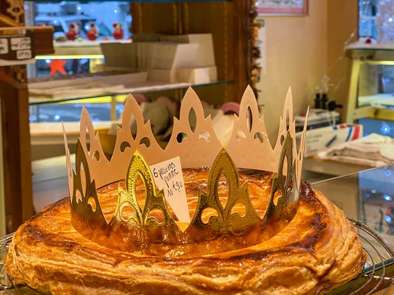 Puff pastry with almond filling, topped with a gold paper crown - a galette des rois, Kings cake